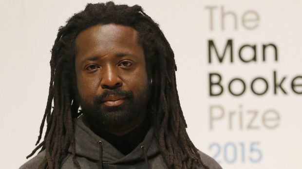 Author Marlon James poses on stage at the Royal Festival Hall in London.