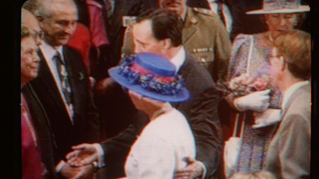 Paul Keating causes a stir when he placed a hand on Queen Elizabeth's back in 1992.