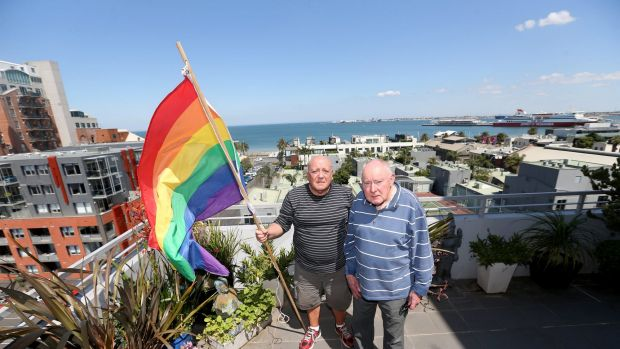 James Bellia and Murray Sheldrick on the balcony of their Port Melbourne apartment, after being told to stop flying ...