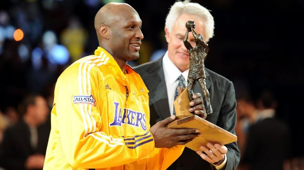 Talented player: Lamar Odom of the Los Angeles Lakers receives the Six Man of the Year Award from Lakers general manager ...