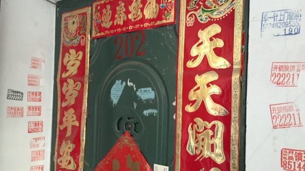 'We are being monitored': The door of the apartment in Ulanhot, Inner Mongolia, where Bao Zhuoxuan is staying with his ...