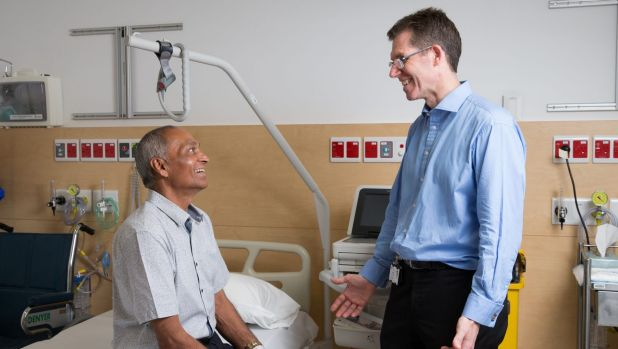 Dr Charles Brooker with Jaswir Grewal, who has received a spinal implant to relieve back pain, at Royal North Shore ...