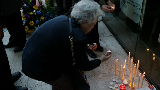 People gather to hold a candle light vigil in memory of murdered police IT worker Curtis Cheng