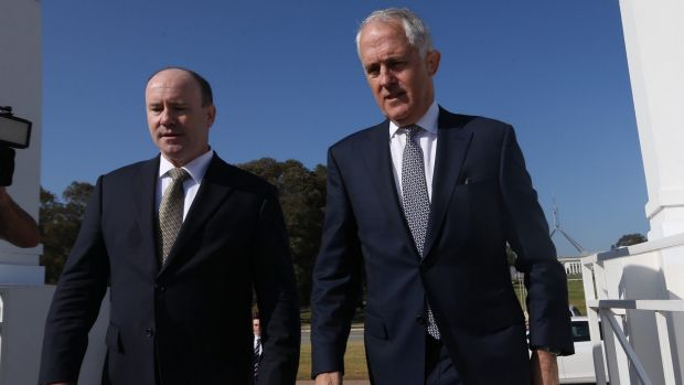 Prime Minister Malcolm Turnbull arrives for the summit with national counter-terrorism co-ordinator Greg Moriarty.