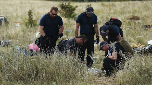 Australian Federal Police officers and their Dutch counterparts at the MH17 crash site in the fields outside the village ...