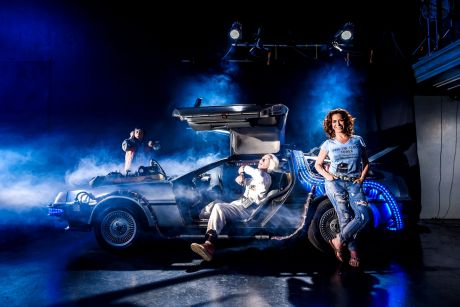 Back to the present: Claudia Wells and a replica DeLorean in a Campbellfield warehouse.