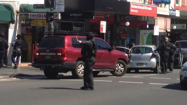 A police officer stops traffic after a grey Toyota (right) was pulled over.