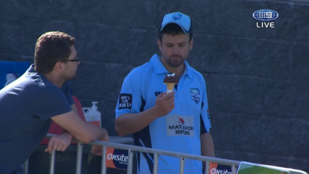 Caught: Ed Cowan is sprung demolishing a choc-top at the Matador Cup game between New South Wales and Queensland