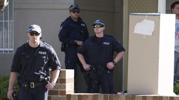 Police raid a property in Punchbowl as they target an alleged extortion scam.