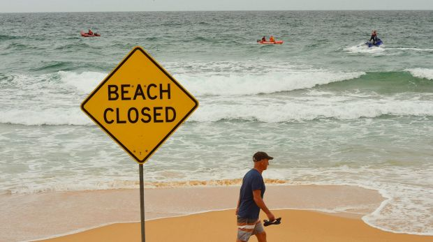 Curl Curl beach has been closed as authorities search for a missing man on Sunday.