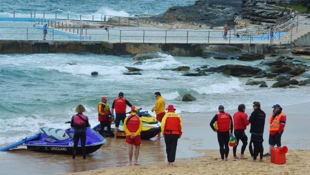 Surf Life savers and rescue prepare to enter the water in the search at Curl Curl Beach.