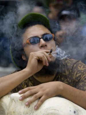 A man smokes a marijuana cigarette during a protest in Mexico City.
