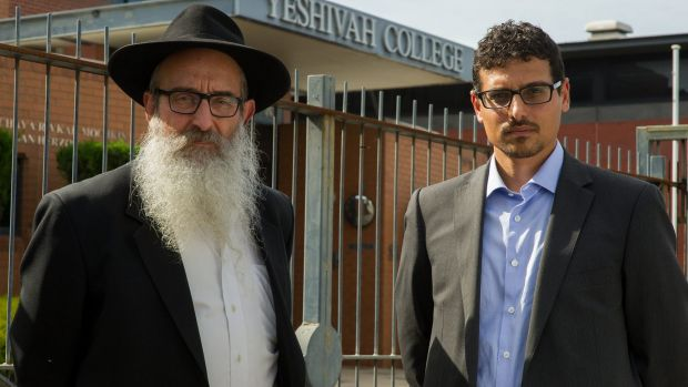 Manny Waks, right, with his father Zephaniah in front of the Yeshivah College.