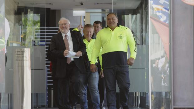 CFMEU organiser John Lomax, right, leaves the court with lawyer John Agius after having a blackmail charge dropped.