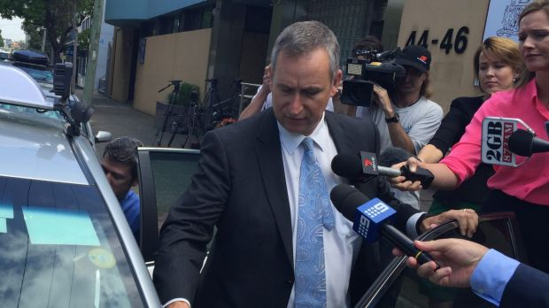 Pitt Town Public School principal Michael Miller leaves the NSW Coroner's Court.