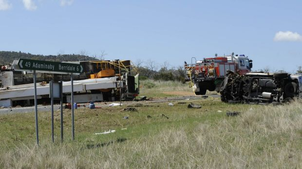 The driver and passenger of a four-wheel-drive were killed when their car and a semi-trailer collided.