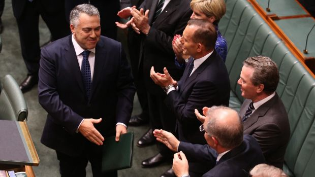 Happier times: Mr Hockey is congratulated by colleagues after his second budget in May this year.