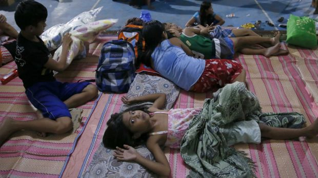 Typhoon evacuees are housed in a school gymnasium in Cabanatuan, northern Philippines.