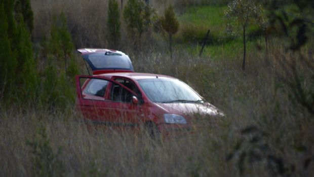 The crashed car, which was being forensically examined.