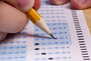Educational research says there is no link between high-stakes tests and improved performance.