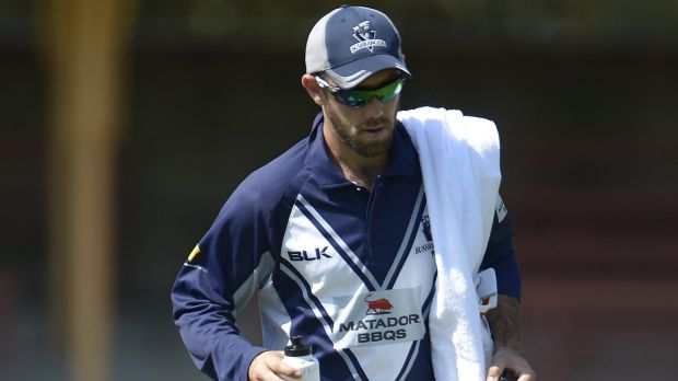 Sidelined: Glenn Maxwell carries the drinks for Victoria this week.