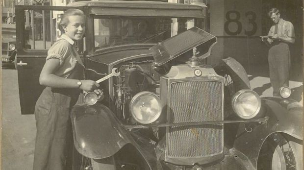 Sheila Agnes Grey (then Williamson) working as a mechanic at the Williamson's family garage on Cooma Street, Yass, aged 16.