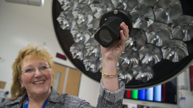 Barb Collins points out a high-definition camera built into a surgical light at the Humber River Hospital. The camera ...