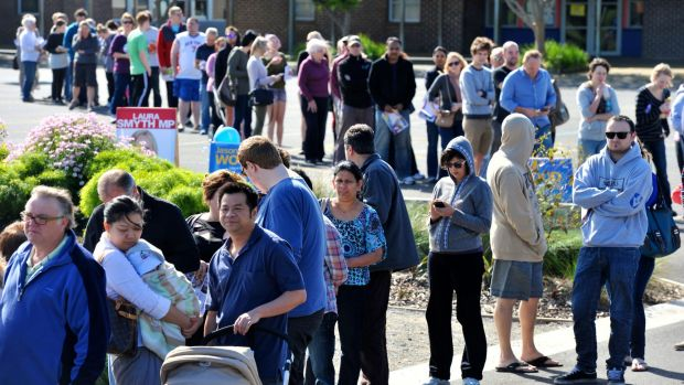 A long line of voters outside a polling place at Timbarra Primary School in Melbourne.