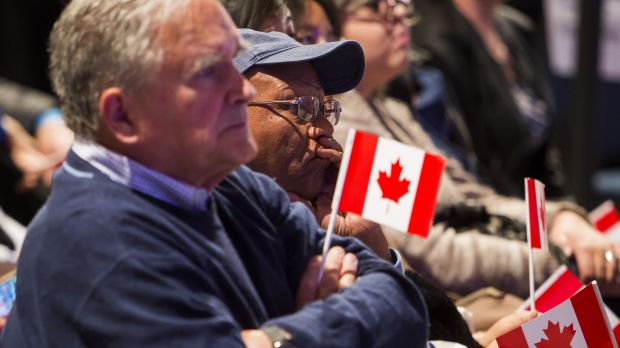 Supporters of Conservative Leader Stephen Harper watch the polls as broadcasters project a Liberal Party victory on ...