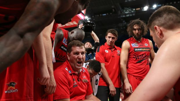 Wild in the west: Perth coach Trevor Gleeson addresses his Wildcats players at a time-out.