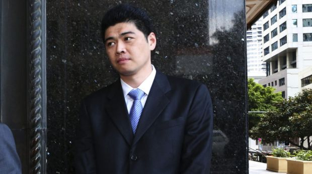 Narkena's business manager Perry Wu leaves the Downing Centre Local Court.