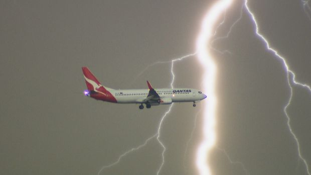 Lightning flashes behind a Qantas plane, as captured from La Perouse on Tuesday evening.
