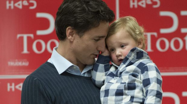 Trudeau holds his son Hadrien during a campaign event in Iqaluit, Nunavut.