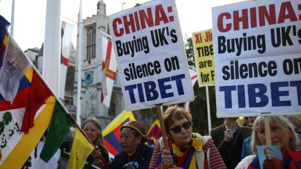 Tibetan independence activists demonstrate near Parliament in London before the visit by Chinese President Xi Jinping.