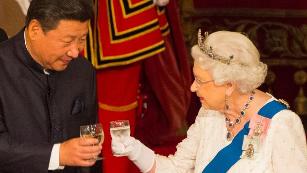 Chinese President Xi Jinping and Queen Elizabeth II clink glasses at a state banquet at Buckingham Palace.