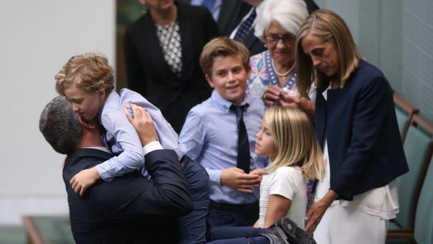 Former Treasurer Joe Hockey embraces his youngest son Iggy after his valedictory speech at Parliament House in Canberra ...