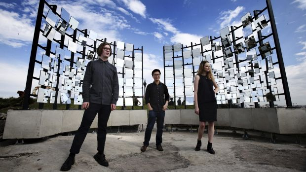 Matthew Asimakis, Clarence Lee and Caitlin Roseby with their sculpture 'Half Gate'.