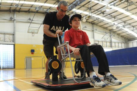 ANU science communicator Dr Graham Walker demonstrated a hoverboard at the ANU indoor sports centre. Henry Crane, 9, ...