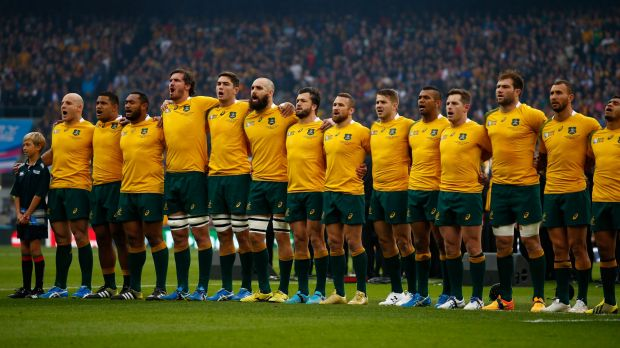 United they stand: The Australia team sings the national anthem prior to kickoff against Scotland.