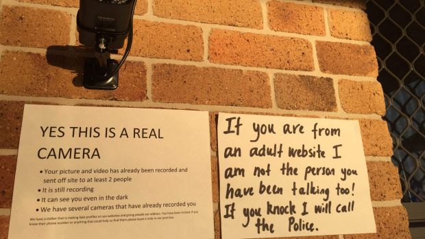 Signs and security put up by Robyn Night and her husband in response to dozens of visits from men expecting sex.