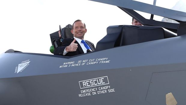 Former prime minister Tony Abbott poses in the cockpit of a replica of the F-35A Lightning II Joint Strike Fighter at ...