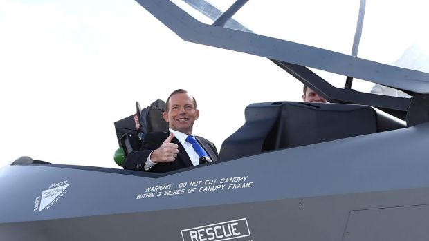 Then prime minister Tony Abbott in a replica F-35 jet in Canberra in 2014.
