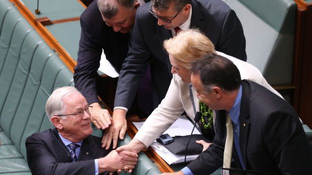 Then trade minister Andrew Robb is congratulated after he concluded the second reading debate on the China - Australia ...