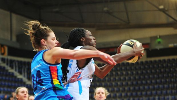 Canberra Capitals' Rosie Fadljevic and South East Queensland Stars' Ify Ibekne in action.