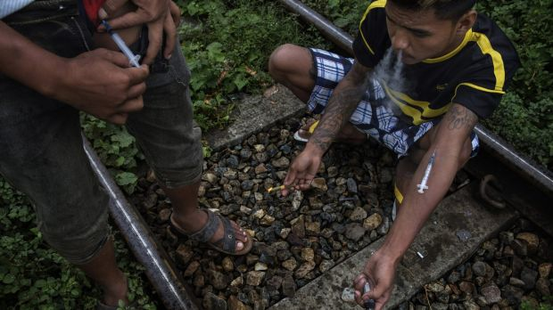 Drug addicts inject heroin in the Kachin State of Myanmar last year.The drug and jade trades in Myanmar have become a ...