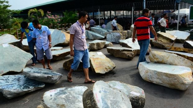 Merchants walk near jade stones displayed at annual Gems Emporium in the capital Naypyitaw, Myanmar this month.
