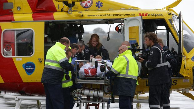Medics work to stabilise shark attack victim David Quinlivan before he was flown by rescue helicopter to John Hunter ...