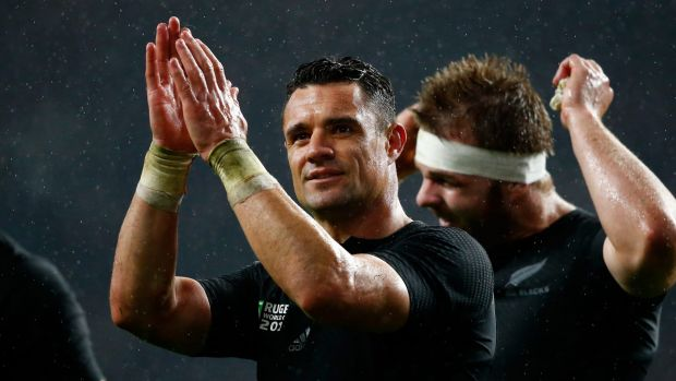 Give yourself a hand: Dan Carter celebrates the All Blacks win over South Africa.