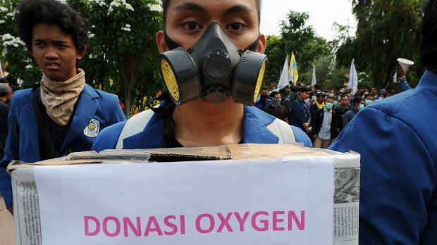 Indonesian students in Surabaya collect donations for victims of smog pollution during a protest to condemn the ...