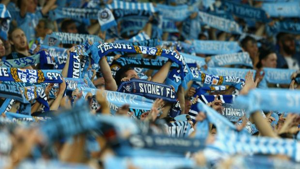 Fired up: Sydney FC fans display their scarves during the match against Western Sydney in October.